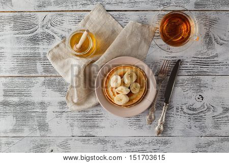 Pancake With Banana, Covered With Honey Or Maple Syrup With Copy Space