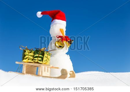 Funny Snowman And A Sledge With Presents In The Snow