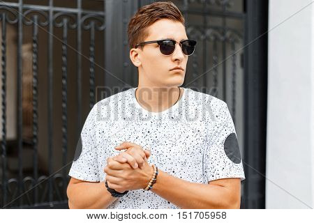 Handsome Man Rubs His Hands. Outdoor Portrait