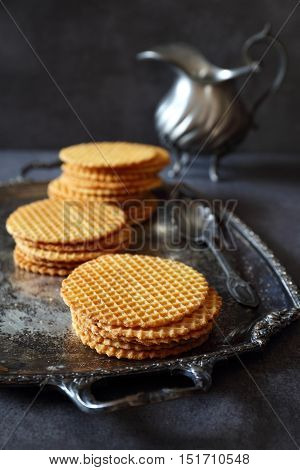 French waffles traditional norman biscuit and vintage dish dark photo