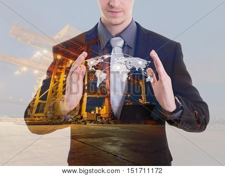 Double exposure of businessman in protecting global network coverage world mapIndustrial Container Cargo freight ship at habor for Logistic Import Export background (Elements of this image furnished by NASA)