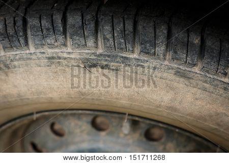 old black tires of car wheel on road