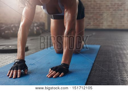 Female Working Out On Exercise Mat