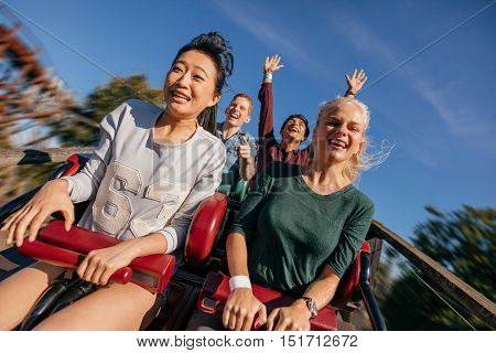 Group Of Friends On A Thrilling Roller Coaster Ride