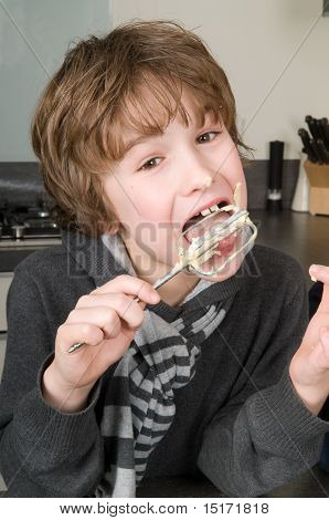 Boy Eating Dough From A Beater
