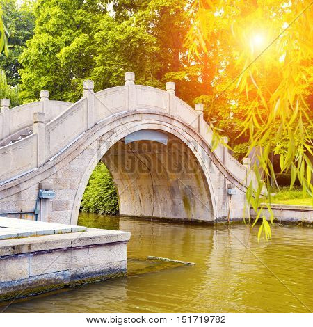 Ancient arch bridge in Hangzhou West Lake, China