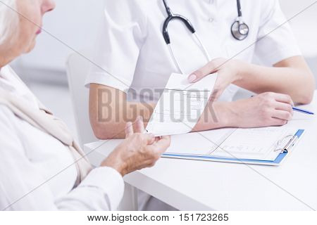 Doctor Giving The Prescription