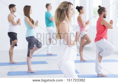 Yoga Instructor Standing With Other Practitioners