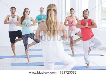Yoga Trainer Standing On One Leg
