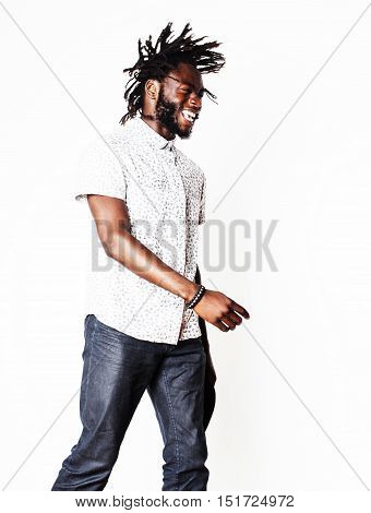 young handsome african american boy singing emotional with microphone isolated on white background, in motion gesturing, lifestyle people concept close up