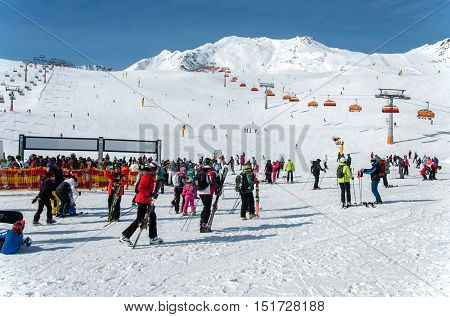 SOLDEN, AUSTRIA - MARCH 4, 2016: Crowd of skiers and chairlifts in Alpine ski resort in Solden in Otztal Alps Tirol Austria