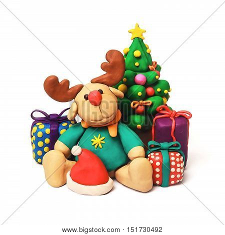Plasticine cartoon deer with present and Christmas tree on a white background