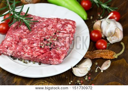 Raw fresh minced meat on plate - ground beef meat