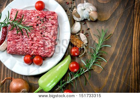 Fresh ground beef meat with seasonings - minced beef on plate
