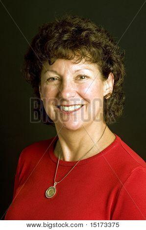 Attractive Middle Age Senior Woman Studio Portrait Euro Coin Necklace