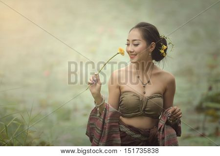 Lao Gan girl dressed in folk happy.