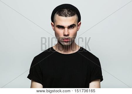 Front view of confident motionless man looking at camera. Studio shot.