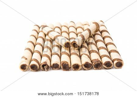 wafer rolls with chocolate isolated on white background