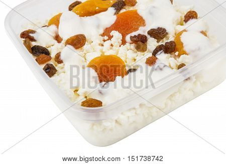 Cottage Cheese With Dried Apricots, Raisins And Yogurt In Container