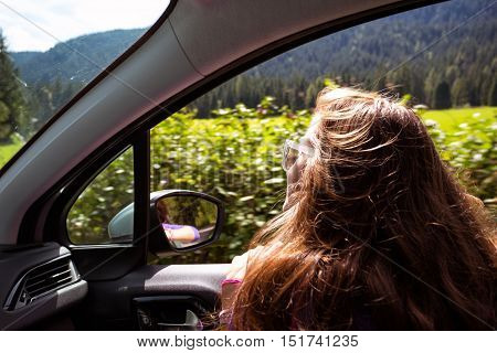 Girl Traveling In A Car
