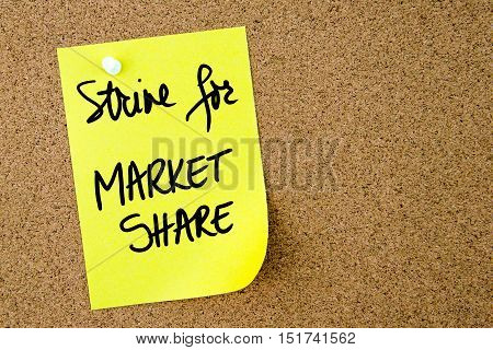Strive For Market Share Text Written On Yellow Paper Note