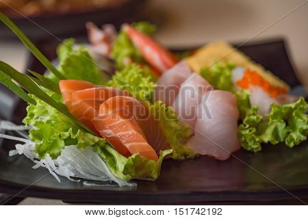 Close up of japanse food call sashimi made from fresh seafood in local japanese restuarant tokyo japan.