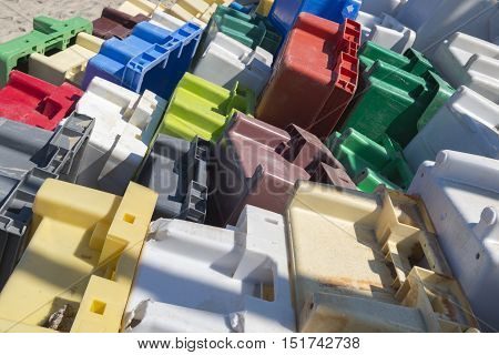 Colourful collection of old exhibited plastic crates