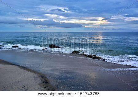 Seashore Sunrise with Heavenly Skies Above Ocean