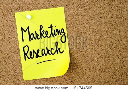 Marketing Research Text Written On Yellow Paper Note