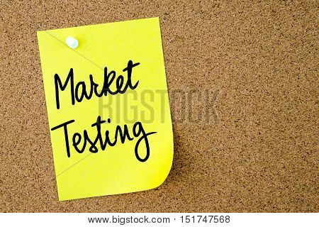 Market Testing Text Written On Yellow Paper Note