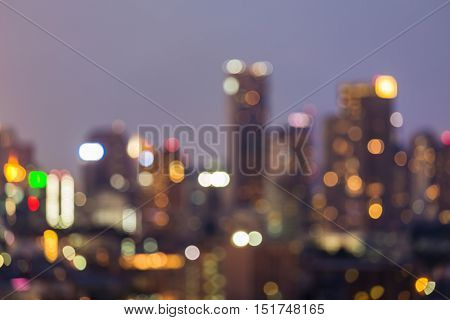 Blurred bokeh lights city office building night, abstract background