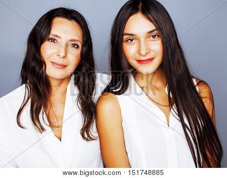 cute pretty teen daughter with mature mothr hugging, fashion style brunette mulatto