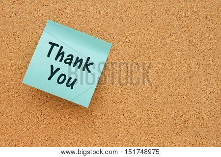 Thank You message Bulletin board with a teal sticky note with text Thank You