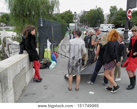PARIS FRANCE - CIRCA AUGUST 2011: Unidentified models striking a pose for a fashion photo set