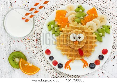 Creative idea for kids breakfast - wafer kiwi banana orange shaped turkey cute and funny kids food Thanksgiving dessert top view