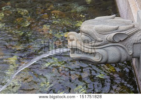 Dragon statue water spray in public park