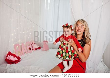 Mother Hold On Hands Baby Girl, Sitting On Bed