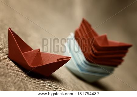 colored paper boats concept of business success