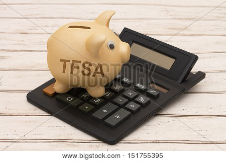 Your TFSA Savings A golden piggy bank and calculator on a wood background with text RRSP
