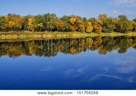 beautiful landscape of the lake in autumn sunny day