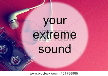 audiocassette and earphones on red background sound