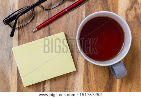 Notepad With Tea Background On Wood Concept