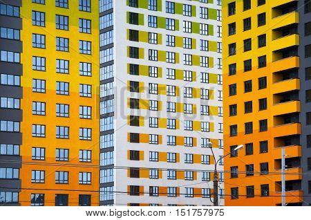 Russia - June 08: City landscape - color bright new high-rise buildings with windows in a row June 08 in Russia, Nizhny Novgorod