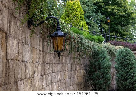 Forged Lantern On A Brick Wall