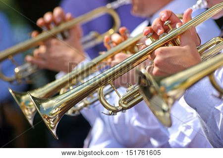 Close up view of the trumpets in brass band