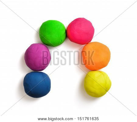 Arch made of colorful balls of modelling clay isolated on white background. Joy and creativeness. Bright plasticine. Elementary school.