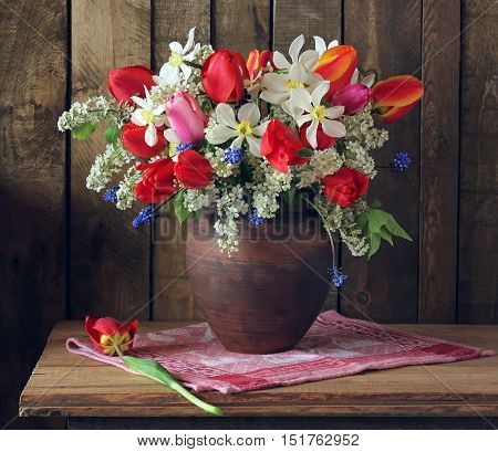 Still life with spring bouquet of tulips daffodils and cherry.