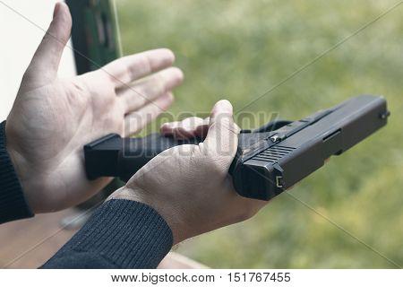 Loading Handgun. Reloading handgun. Loading pistol. Reloading.