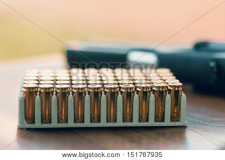 Gun With Bullets. Handgun Box With New Ammunition.