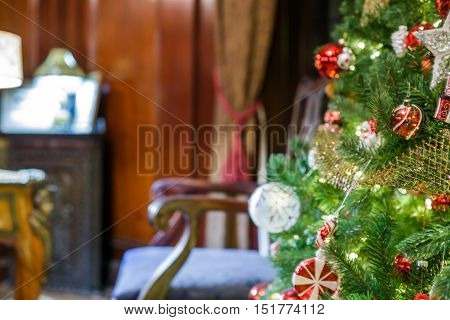 Closeup of decorated Christmas tree at old interior